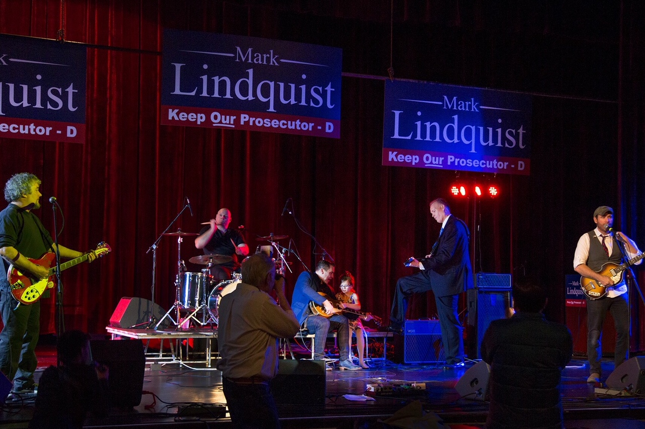 Prosecutor Mark Lindquist playing guitar
